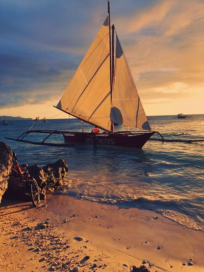 Nautical Vessel Water Sky Sea Boat Mode Of Transport Nature Outdoors Beauty In Nature Transportation Cloud - Sky Outrigger Scenics Sunset Beach Tranquility No People Longtail Boat Horizon Over Water Day