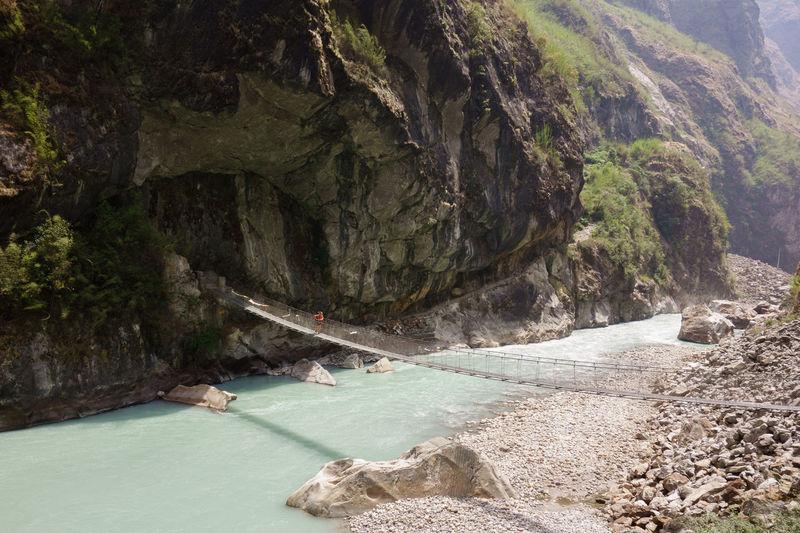 Bridge over sea against mountains