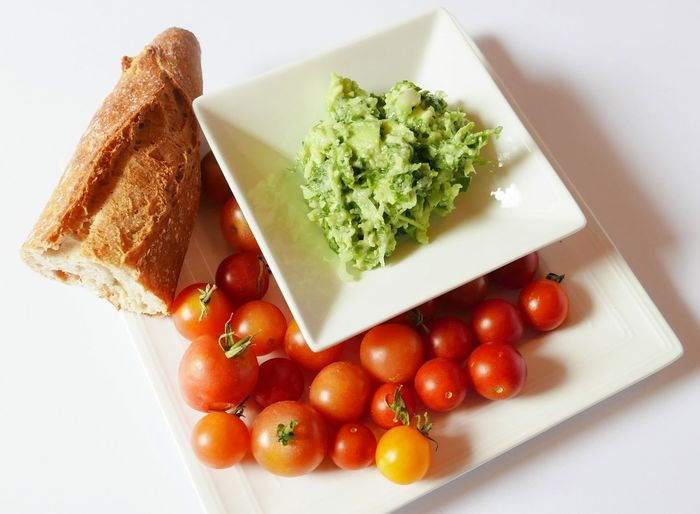 High Angle View Cherry Tomatoes With Bread In Plate On Table
