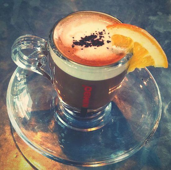 Jamie's Italian Orange. Shot of coffee, shot of orange liqueur, shot of hot chocolate, layer of cream garnished with an orange. Shot Of Coffee With Orange Liqueur Jamie's Italian