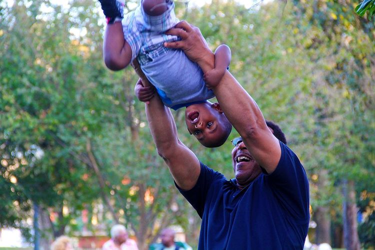 The love of a father New Orleans Louisiana Sky Close-up Fun Child Father Men Happiness Adult Togetherness Outdoors Africa African Focus On Foreground Males  Day People Smiling Tree Bonding Lifestyles Young Adult Piggyback Cheerful