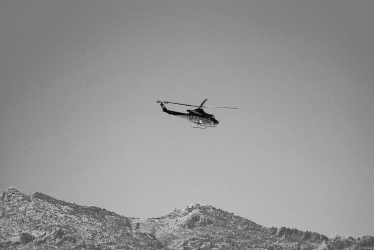 Low Angle View Of Helicopter Flying Against Clear Sky