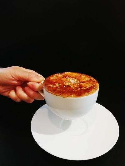 holding a cup of coffee Cup Coffee Drink Hot Drink Human Hand Black Background Comfort Food Studio Shot Plate Holding Food And Drink Sweet Food Close-up Black Coffee Cappuccino Latte Tea Cup Beverage Black Tea