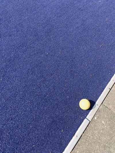 High angle view of yellow ball on road