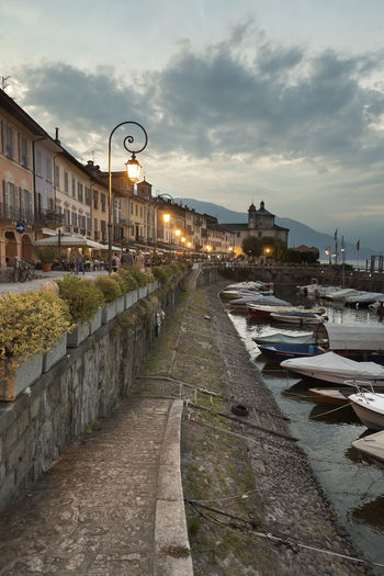 Sunset in the port of Cannobio, locality and Italian comune of the province of Verbano-Cusio-Ossola, Piedmont region, with 5,128 inhabitants. Architecture Sky Cloud - Sky Built Structure Building Exterior Water City Transportation Street Nature Mode Of Transportation Street Light Lighting Equipment The Way Forward Dusk Nautical Vessel Illuminated Footpath Canal Outdoors Diminishing Perspective Cannobio Italy Cityscape Harbol