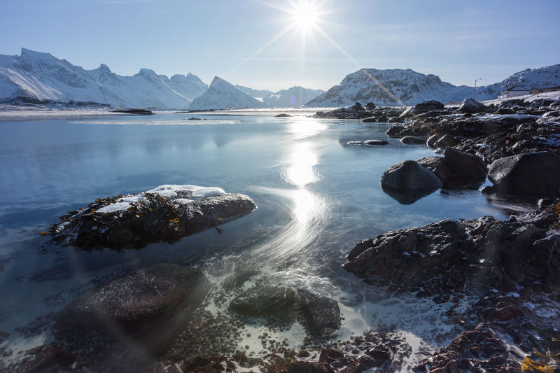 Moving ice in Ytresand Moving Ice Norway Winter Ytresand Beauty In Nature Cold Temperature Day Landscape Mountain Nature No People Non-urban Scene Outdoors Rock Rock - Object Rocks Scenics - Nature Sea Snowcapped Mountain Sun Sunbeam Sunlight Tranquility Water Winter