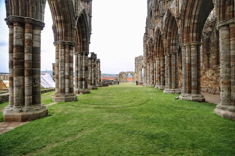 Whitby Whitby Whitby Abbey Architecture Built Structure History The Past Grass Sky Architectural Column Day Travel Destinations Ancient Nature In A Row Travel Tourism Building Exterior Old Ruin Ancient Civilization No People Old Plant Outdoors Colonnade Archaeology Abbey Ruined