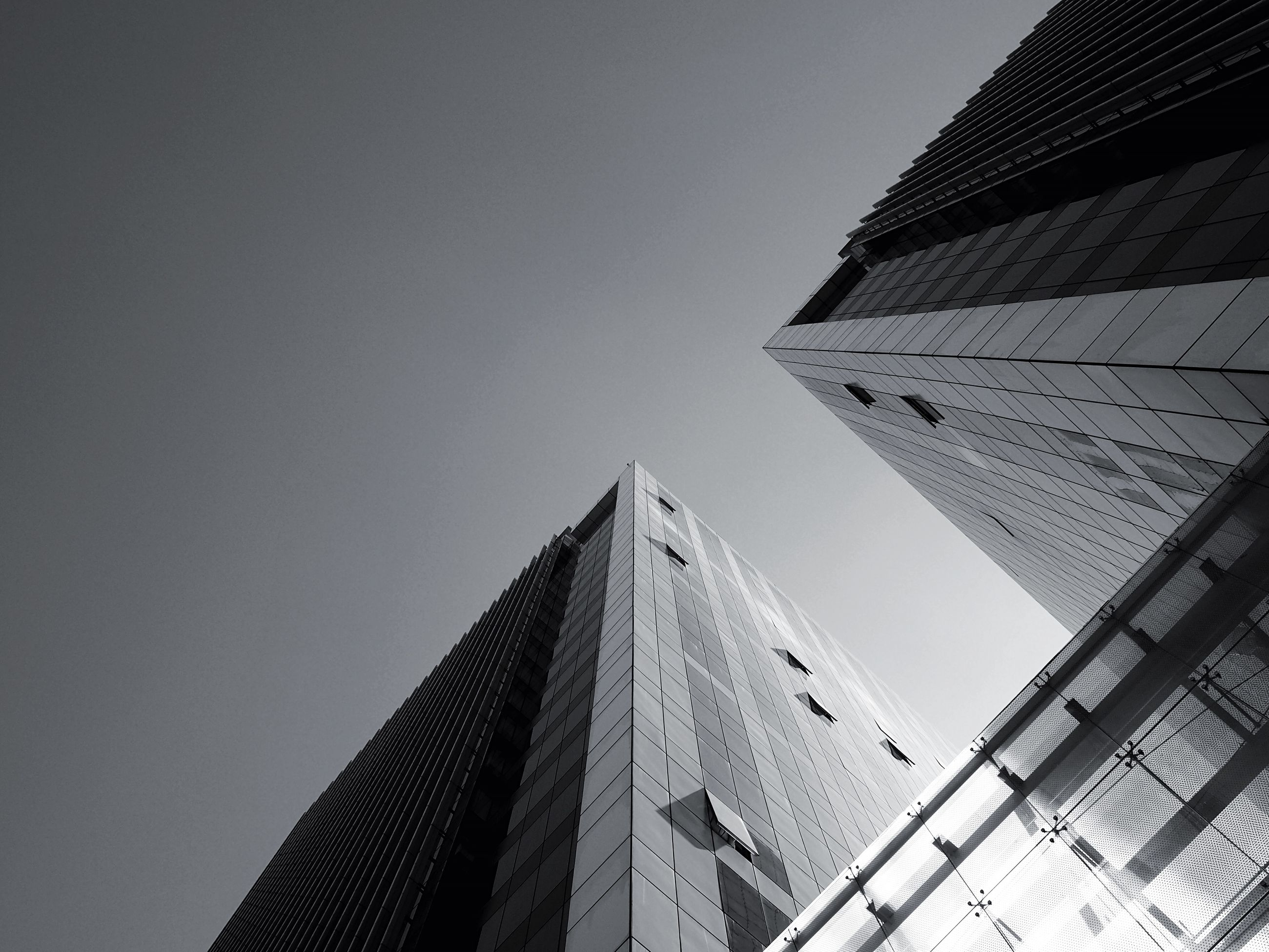 architecture, building exterior, built structure, low angle view, clear sky, city, tower, tall - high, skyscraper, modern, office building, building, day, tall, copy space, sky, outdoors, directly below, city life, no people