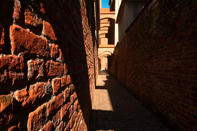 Church Path Arch Architecture Brick Building Exterior Builfing Exterior Built Structure Day Historical Building Light Light And Shadow No People Old Town Outdoors Poland Shadow The Way Forward Water