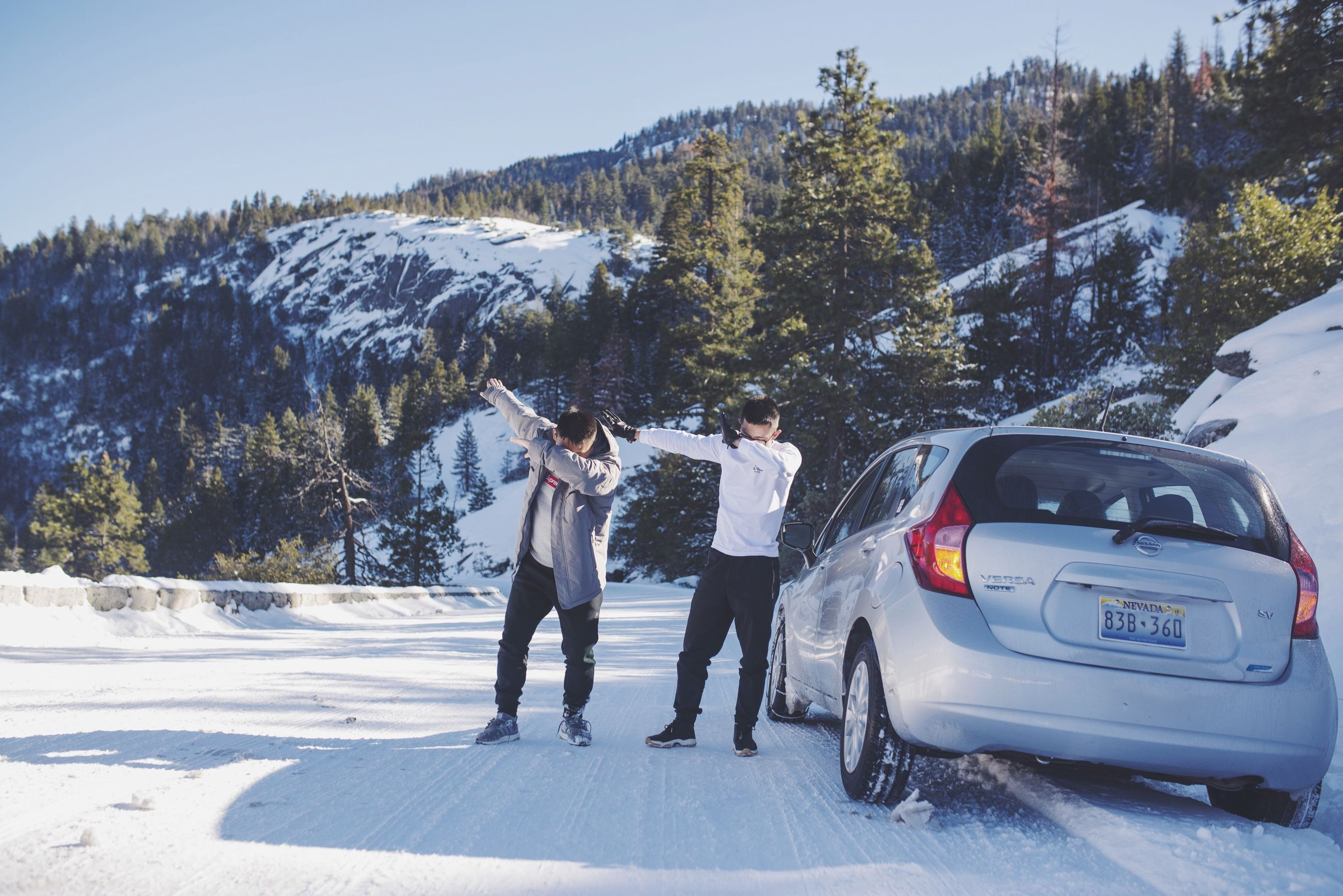 snow, winter, cold temperature, season, men, lifestyles, leisure activity, mountain, tree, full length, walking, person, rear view, transportation, road, weather, travel, togetherness