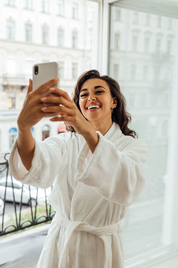 Young woman using mobile phone in camera