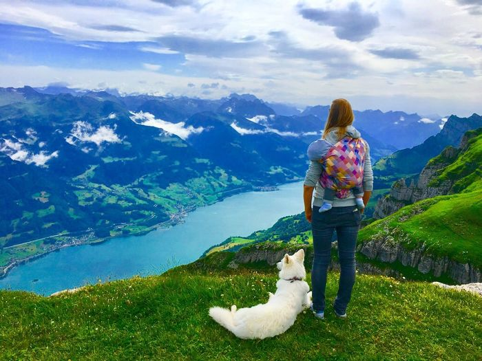Dog Carrying Baby Mother One Person Real People Lifestyles Rear View Nature Beauty In Nature Mountain Cloud - Sky Leisure Activity Standing Adult Casual Clothing Scenics - Nature Day Sky Full Length Women Mountain Range Outdoors This Is Family