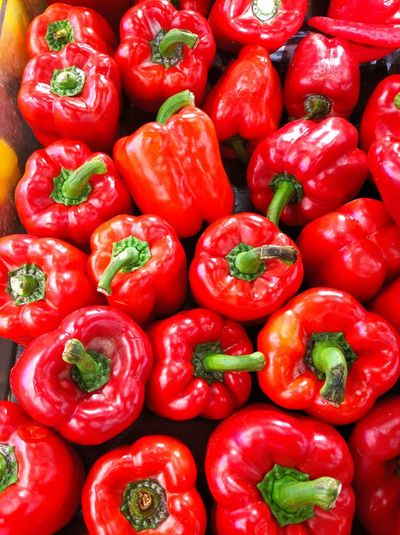 Full frame shot of red bell peppers at market