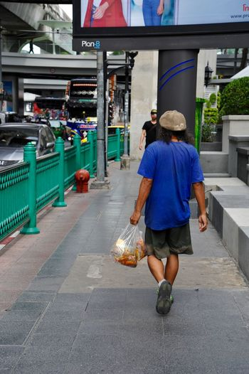 person Photography Rear View Full Length Real People Architecture City One Person Walking Leisure Activity Incidental People Adult Men Bag Street Footpath