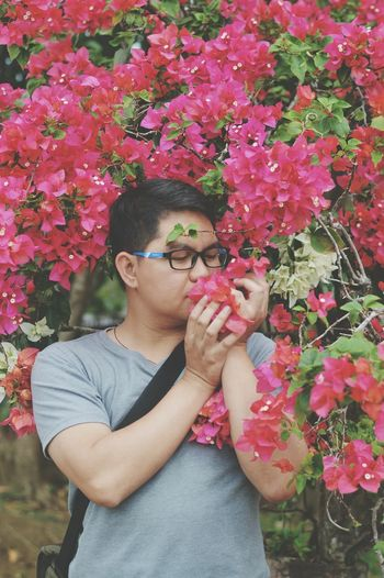 stop and smell the flowers. Human Hand Flower Portrait Flowerbed Red Human Face Tree Plant Bougainvillea Flower Head Blooming In Bloom Pink