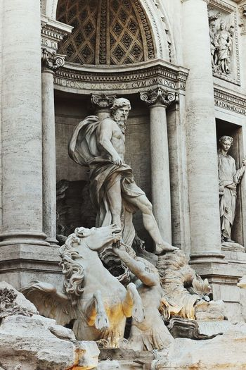 Fontana Di Trevi. Moving Around Rome Sculpture City History Bas Relief Place Of Worship Architecture Close-up Building Exterior Built Structure Sculpted Idol Jesus Christ Statue Art Wat Pho Catholicism Carving - Craft Product Carving