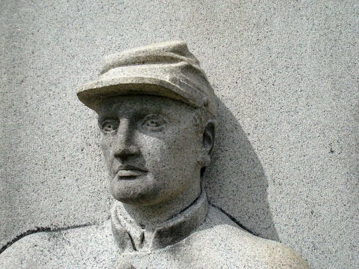 Close-up of soldier sculpture on wall