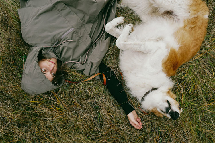 Domestic Domestic Animals One Animal Dog Canine Borzoi Pets Mammal High Angle View Grass One Person Field Relaxation Real People Pet Owner Lifestyles Lying Down Plant Autimn Fall Girl Woman Woman Portrait Hooded Hood - Clothing