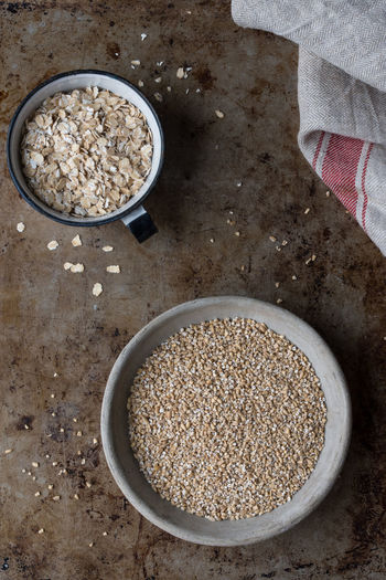 Steel Cut and Rolled Oats Food Food And Drink Healthy Eating Bowl Oats - Food Directly Above Ingredient Raw Food Oatmeal Cereal Plant Macro Bulk Scoop Rolled Oats Isolated Nobody Steel Cut Oats