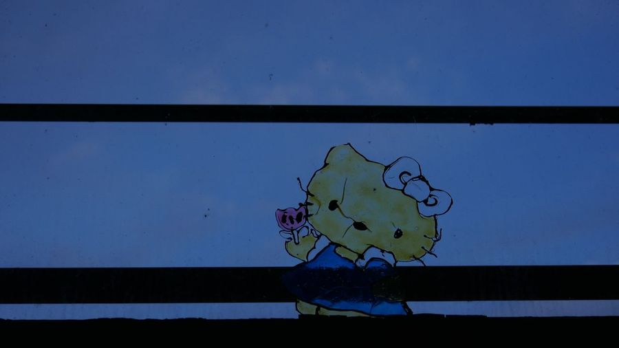 Hey kitty Glass - Material Vitro Glass Hello Kitty No People Wall - Building Feature Day Blue Nature Outdoors Close-up Silhouette Creativity