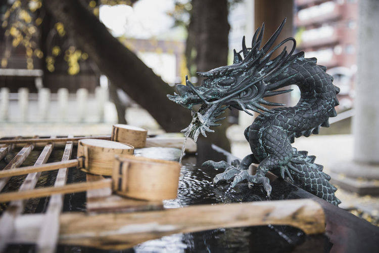 Japanese fountain within a temple in Tokyo. Dragon Fountain Japan Japanese  Japanese Culture Japanese Temple Bamboo - Material Close-up Day Japanese Dragon No People Outdoors Prayer Time Water First Eyeem Photo