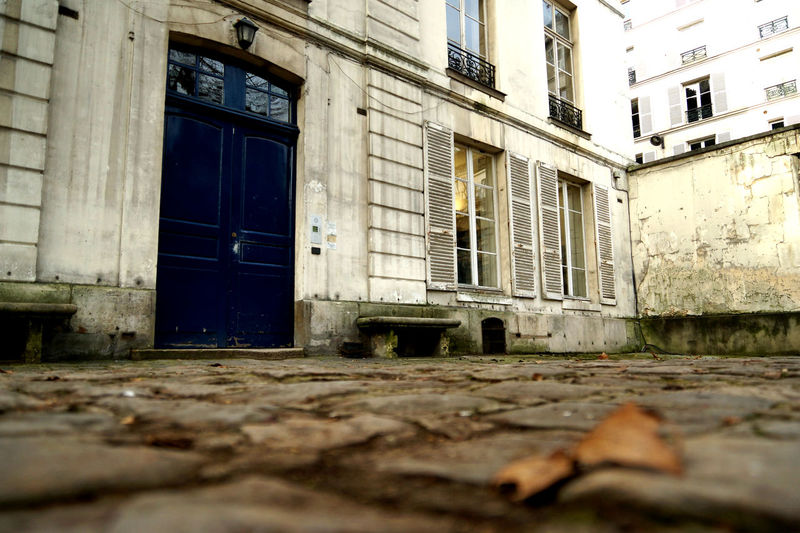 Parisian Backyard Ancient Backyard Decay France Historical Building Low Angle View Paris Architecture Building Exterior Built Structure Day Door Doorway Leaf Light And Shadow No People Old Old Buildings Outdoors Outdoors Photograpghy  Run-down Window Window Shade Windows