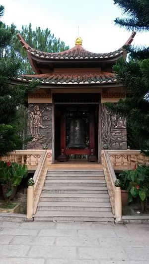 DaLatcity South East Asia Vietnam Architecture Belief Building Building Exterior Built Structure Da Lat Day Entrance Façade No People Outdoors Place Of Worship Plant Religion Shrine Spirituality Staircase Text Travel Destinations Tree