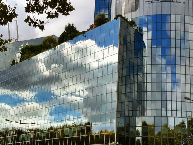 Architecture Built Structure Building Exterior Low Angle View Sky Cloud Cloud - Sky Outdoors Day Tall - High Modern Office Building Urban Skyline No People Town Development Dramatic Sky