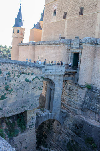 Dont jump Alcázar Segovia Arch Architecture Bridge Building Exterior Built Structure Canal Castle Day History In Front Of Moat No People Outdoors Pit Royal Snapping Artists Sky Stone Material Tower Trench Water Well