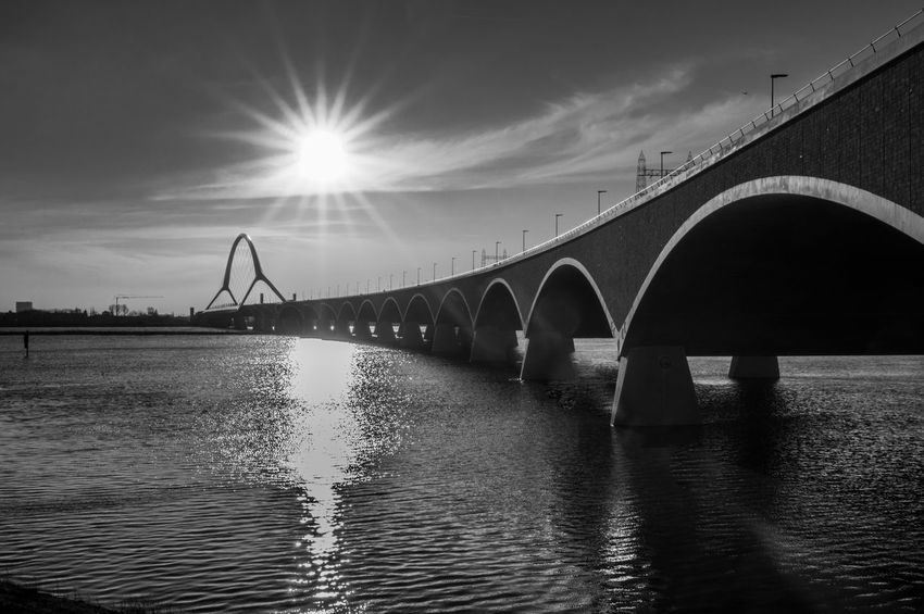 Beautiful Nijmegen Waalbrug Nijmegen Arch Architectural Column Architecture Black And White Photography Bridge Built Structure Cloud - Sky Engineering Holland Lens Flare Long Nature Outdoors Oversteek Reflection River Sky Sun Sunset Transportation Water Waterfront