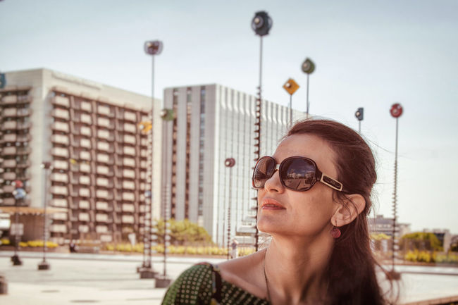 Enjoying a beautiful day in Paris. Canon Urban Geometry Portrait Of A Woman Focus On Foreground Buildings Architecture Architecture EyeEmNewHere City Art Sky Portrait City Life Day Buildings Mood Sunny One Person Only Women The Portraitist - 2017 EyeEm Awards Visual Creativity