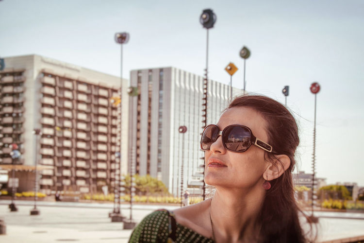 Enjoying a beautiful day in Paris. Canon Urban Geometry Portrait Of A Woman Focus On Foreground Buildings Architecture Architecture EyeEmNewHere City Art Sky Portrait City Life Day Buildings Mood Sunny One Person Only Women The Portraitist - 2017 EyeEm Awards Visual Creativity #urbanana: The Urban Playground
