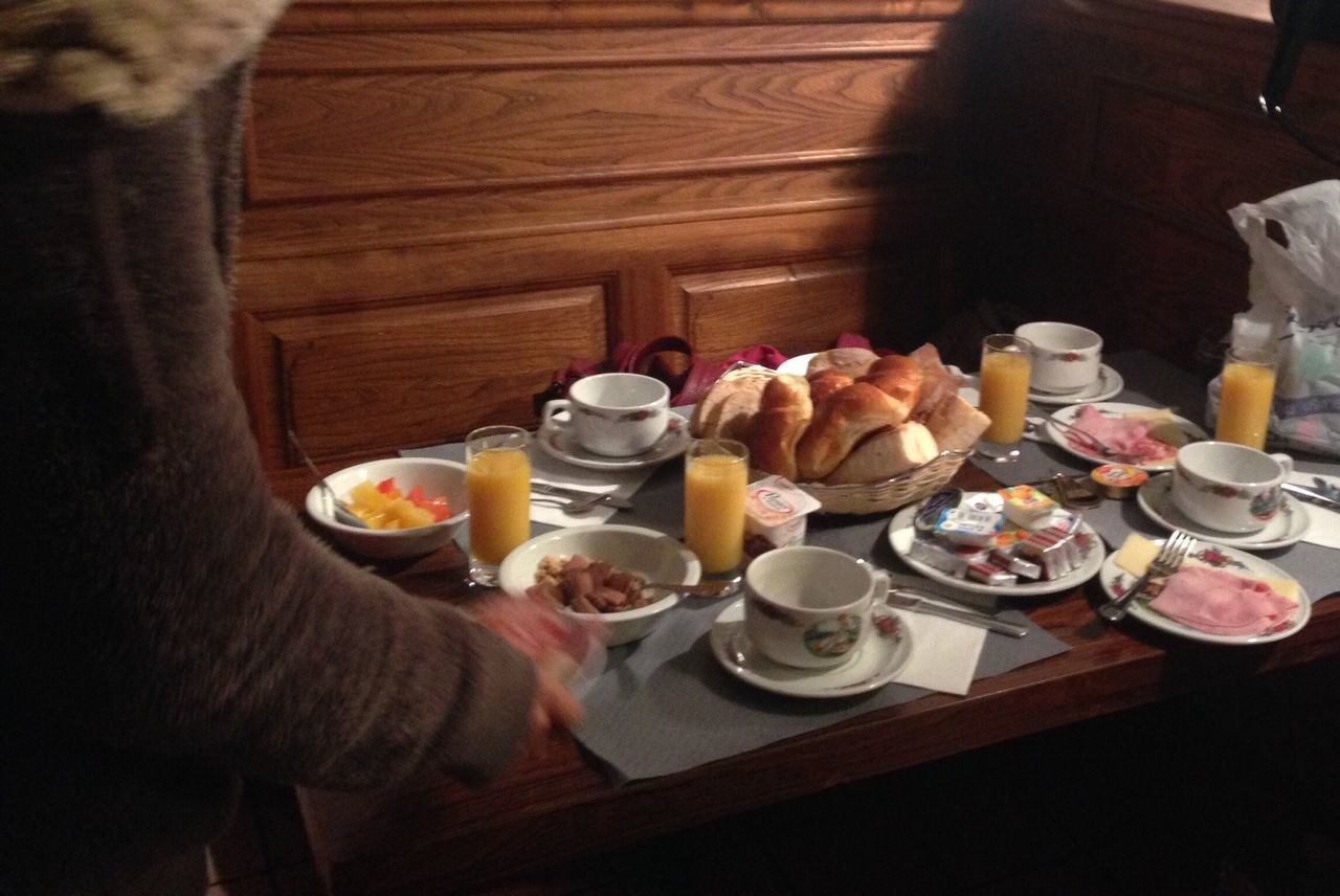 table, indoors, food and drink, tea - hot drink, refreshment, high angle view, teapot, human hand, one person, real people, breakfast, drink, food, day, freshness, people