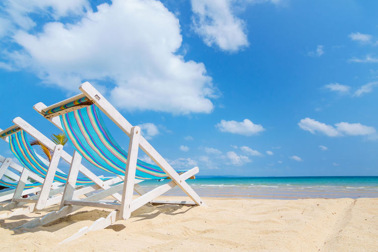 Beach Beauty In Nature Blue Cloud - Sky Day Holiday Nature Outdoors Playground Rest Sand Sea Sky Sleep Sunbathe Tranquility Travel Destinations Vacations Vacations