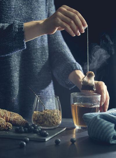 Midsection of man preparing food in jar
