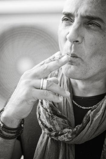 Thoughtful woman smoking cigarette outdoors