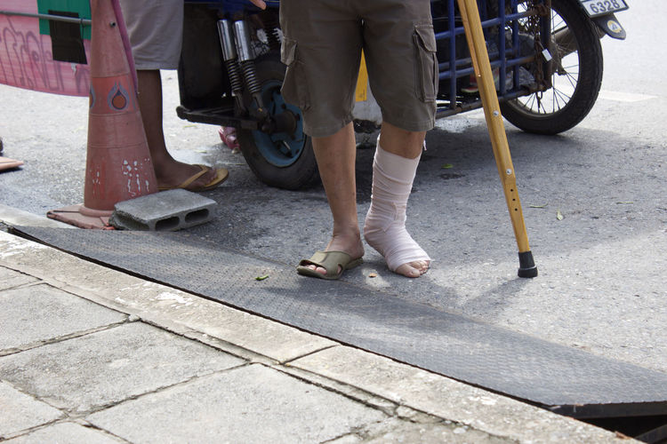 Adult Body Part City Day Footpath Human Body Part Human Foot Human Leg Human Limb Land Vehicle Lifestyles Low Section Men Mode Of Transportation Outdoors Paving Stone People Real People Shoe Standing Street Transportation Two People Wheel A New Beginning Humanity Meets Technology