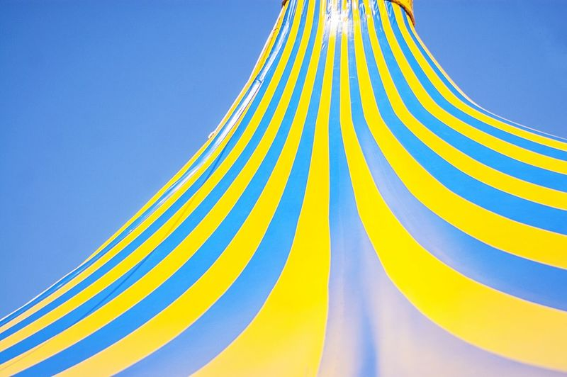 Striped Circus Tent Against Clear Sky
