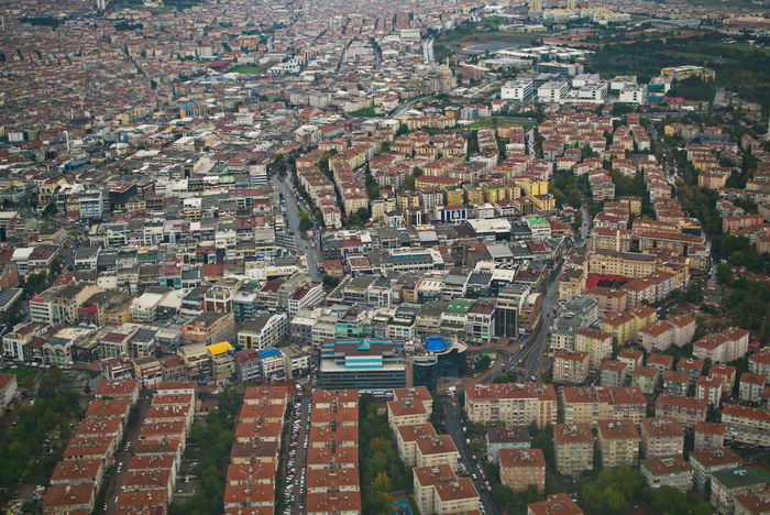 Aerial part of Istanbul city view. Hig population and buildings area Building Exterior Architecture Built Structure City Residential District Building Crowded Cityscape Aerial View High Angle View Crowd Community House Day Nature Town Landscape Environment Outdoors Urban Sprawl TOWNSCAPE Apartment Settlement