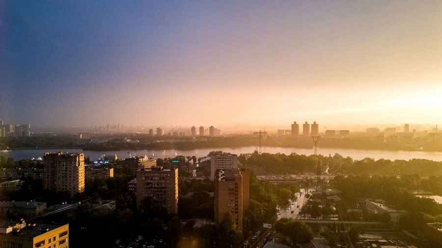 Shot on Samsung galaxy S7 edge. The clear sky after the hailstorm EyeEm Selects City Cityscape Urban Skyline Tree Sunset Skyscraper Autumn Aerial View Sky Architecture Panoramic Skyline Office Building Dramatic Sky Atmospheric Mood Storm Cloud Residential District Settlement Thunderstorm Forked Lightning Cloudscape Romantic Sky Moody Sky Patchwork Landscape Sunbeam Sun Sky Only Shining Heaven
