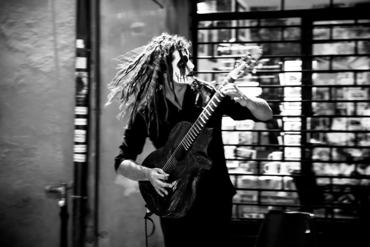 Ferrara Busker Festival Artist Bnw Busker Bw_collection Casual Clothing Culture Guitar Guitarist Lifestyles Long Hair Mask Person Profile Street Streetart Streetphotography Young Adult