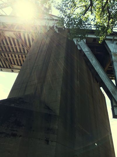 Low Angle View Built Structure Sunlight Lens Flare Bridge Architectural Column