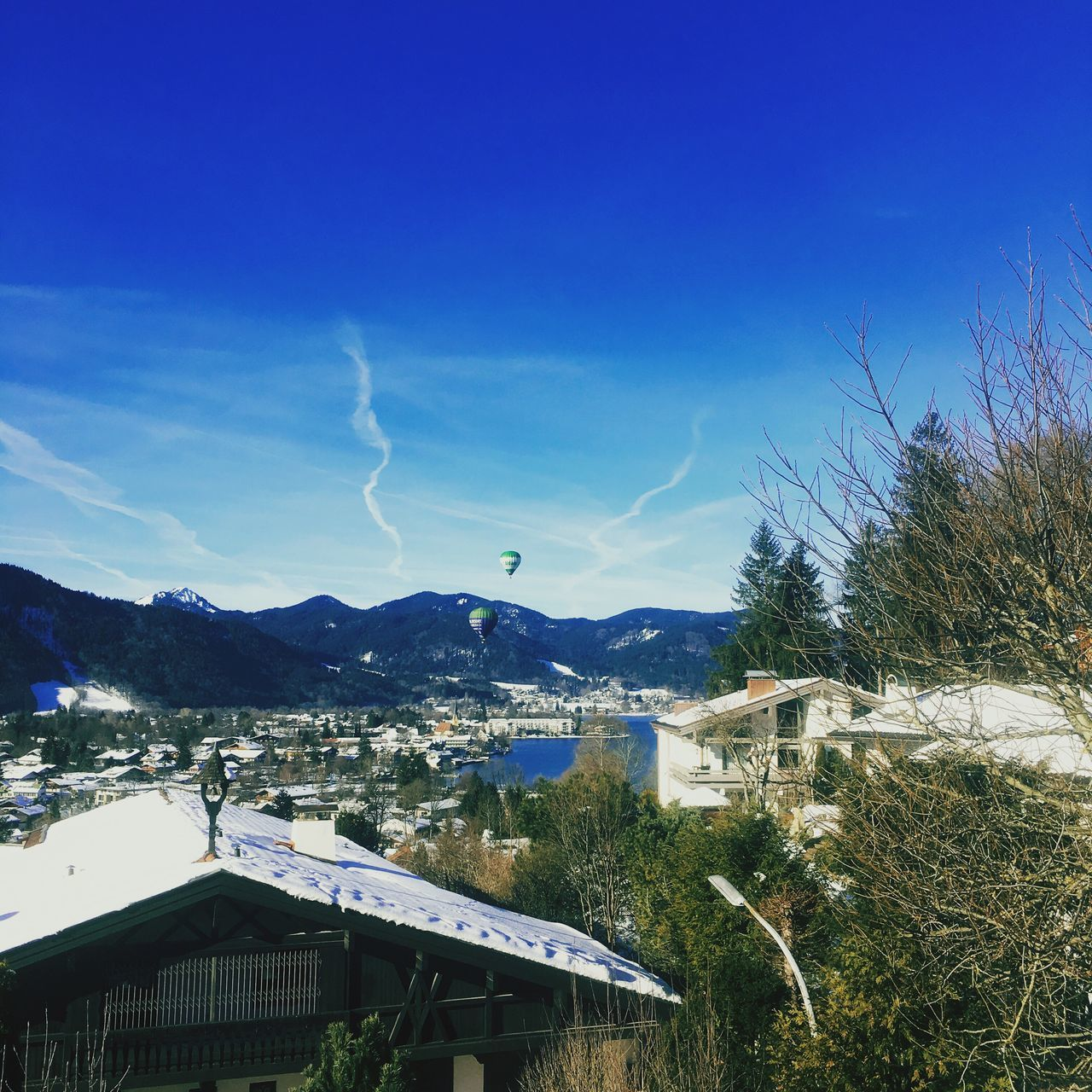 mountain, town, architecture, blue, nature, building exterior, no people, outdoors, tree, day, roof, built structure, beauty in nature, sky, scenics
