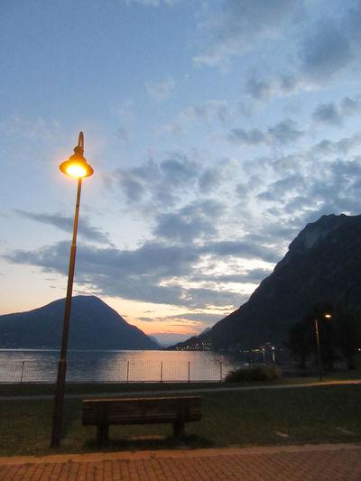 Cloud - Sky Illuminated Lake Mountain No People Scenics Sky Sunset Tranquility