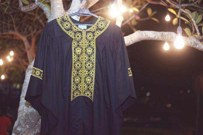 Close-Up Of Clothing Hanging On Illuminated Tree