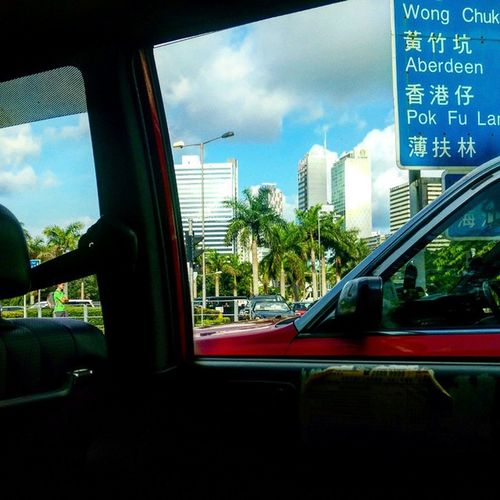 Forever stuck in traffic so close to my work building Aberdeen Latergram HongKong Palmtrees Iliveonholiday Hongkongtaxi Streetsign Bluesky