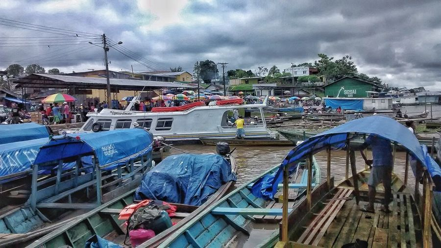Amazonas-Brasil 🇧🇷 Amazonas. Colombia 🇨🇴 Cloud - Sky Sky Nautical Vessel Transportation Boat Mode Of Transport Moored Day Outdoors Water Harbor Large Group Of People Built Structure Men Real People Architecture Sea Building Exterior Nature Mountain