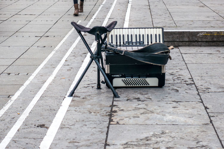 Accordion and stool on street