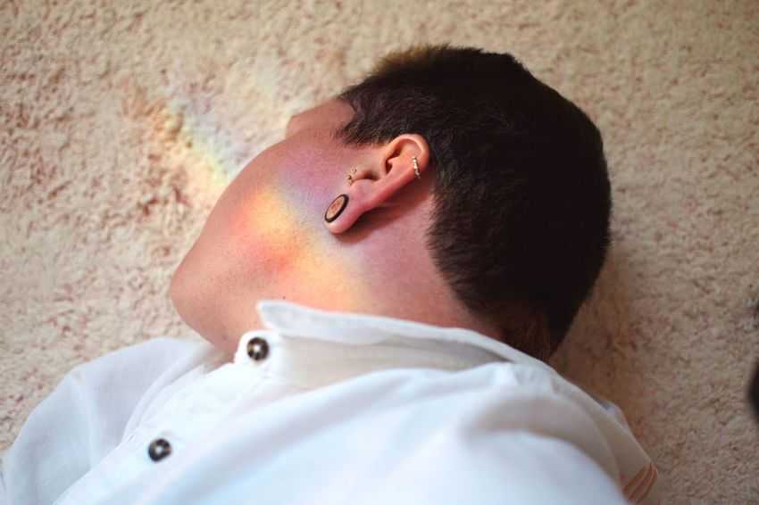 Rainbow kiss. Not Your Cliche Lgbt Pride Rainbow One Person Headshot Portrait Human Body Part Close-up Lying Down Adult Real People White Color Profile View