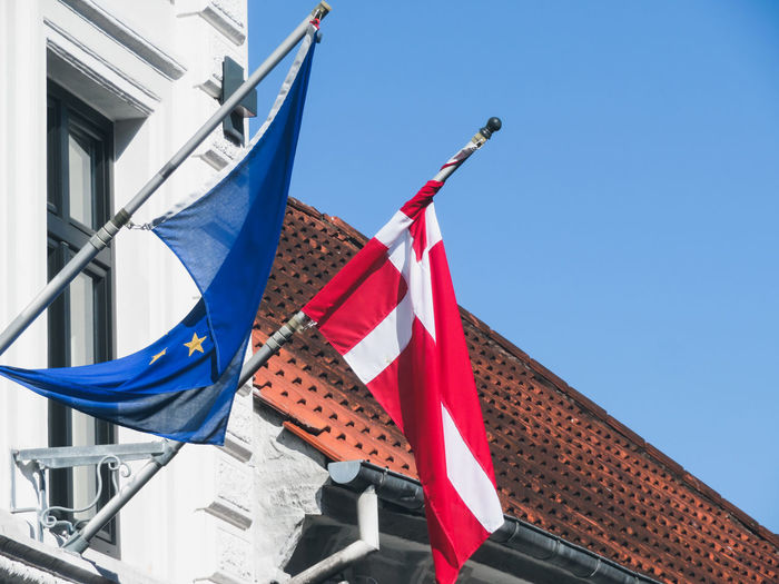 Roof European Flag Danish Flag Hanging Flag Representing Sky Architecture Rooftop Tiled Roof